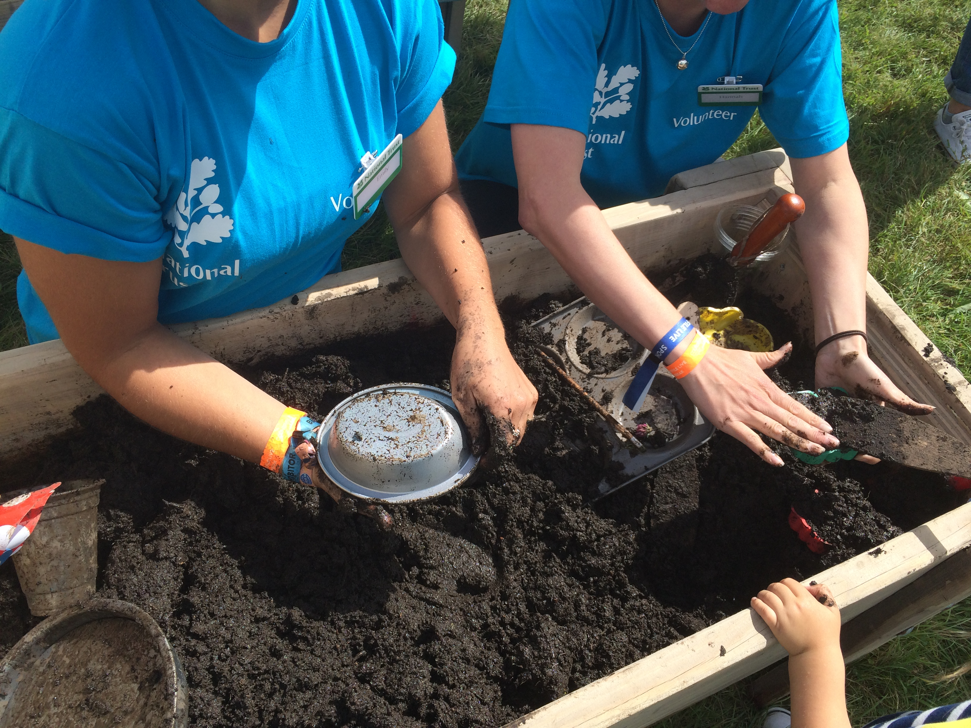 Volunteers playing in the mud pie pit