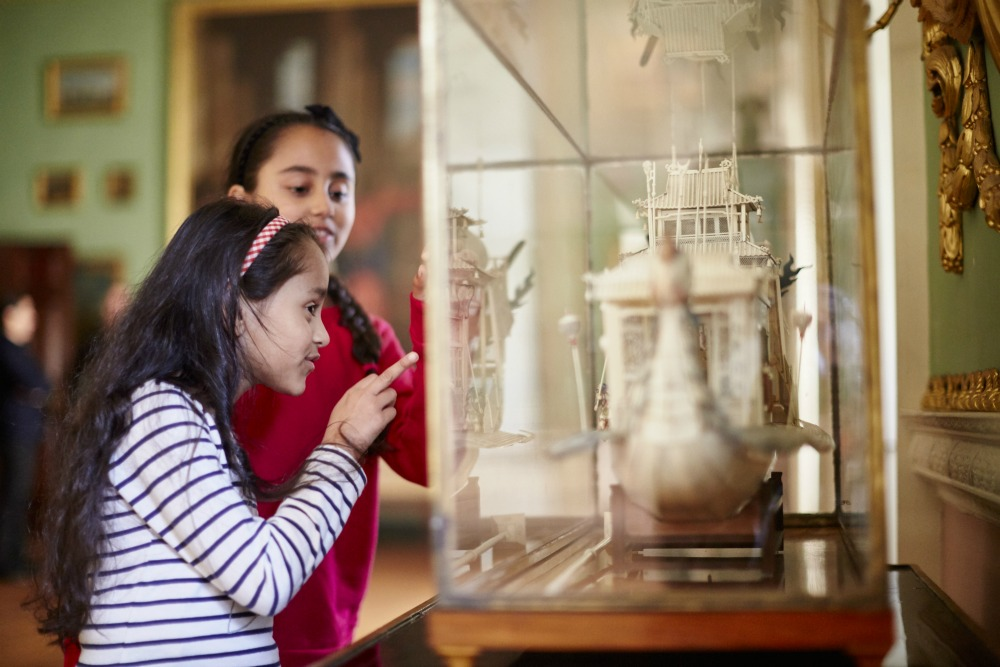 Two girls looking at an exhibit at a National Trust property