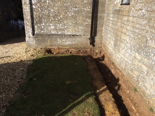 Trench dug around cottage at Sherborne Park